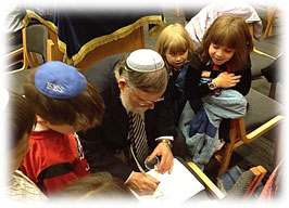 Rabbi learning with children