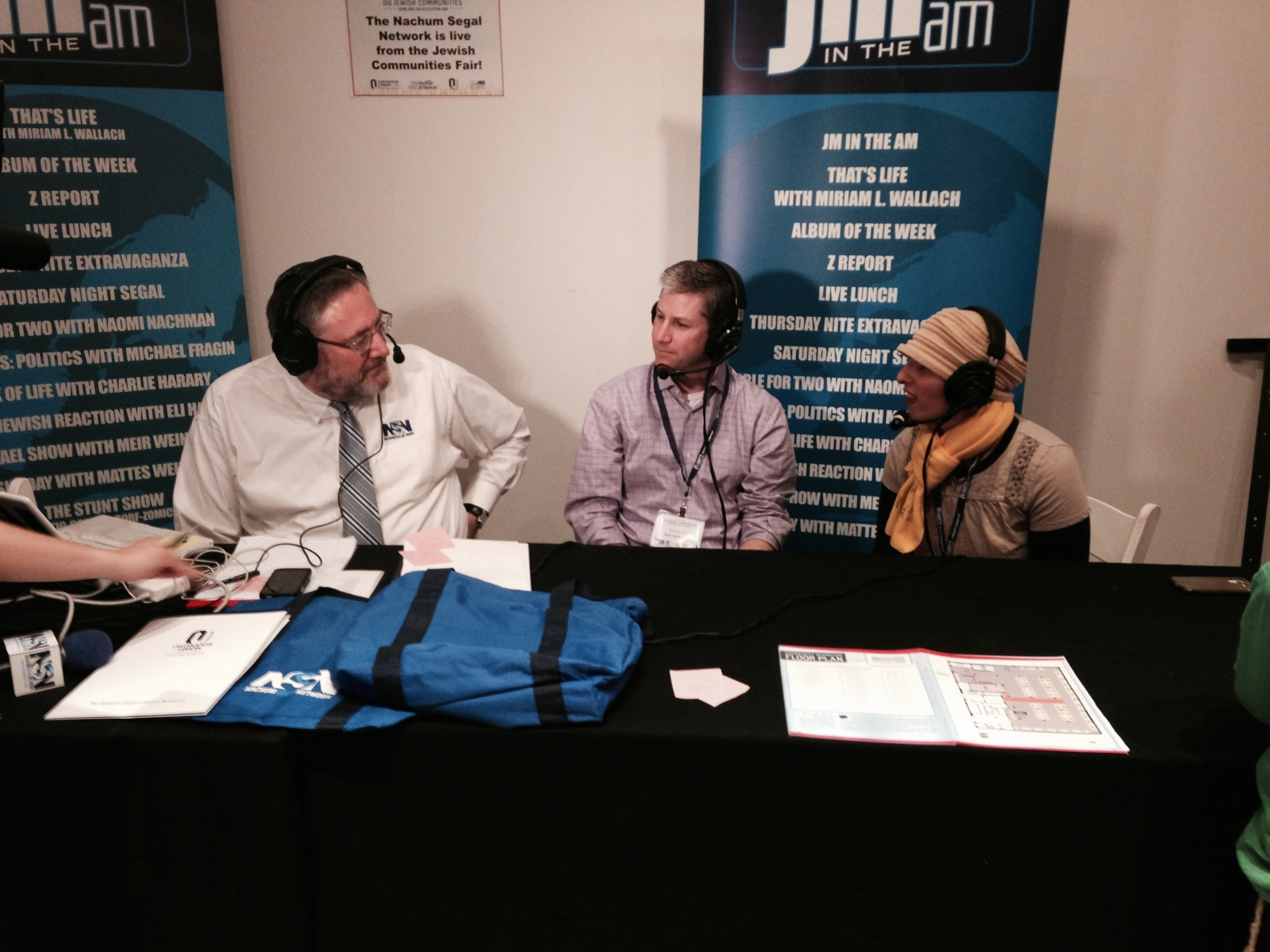 Stuart Kesler and Daniella Robinson Speaking with Nachum Segal at the OU Jewish Communities Home & Job Relocation Fair on April 26, 2015