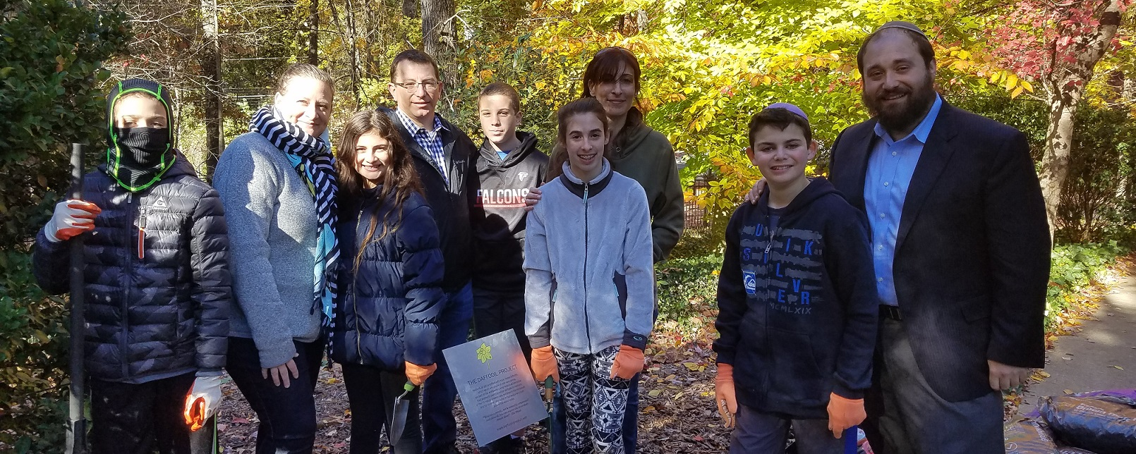 """<span class=""""slider_title"""">                                     Grow With Us                                </span>                                                                                                                                                                                       <span class=""""slider_description"""">Teens plant daffodils for Am Yisrael Chai</span>"""