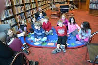 Children learning in the library