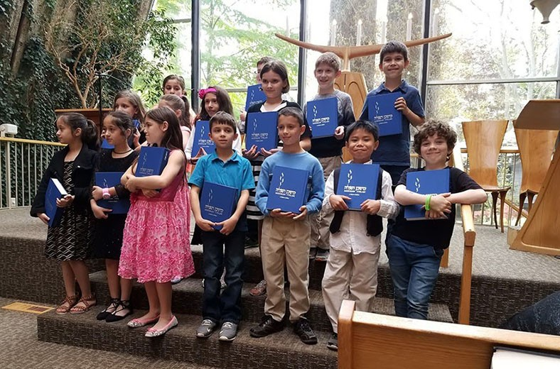 """<a href=""""https://www.tsinai.org/sinai-stories""""                                     target="""""""">                                                                 <span class=""""slider_title"""">                                     Welcome to Temple Sinai                                </span>                                                                 </a>                                                                                                                                                                                       <span class=""""slider_description"""">Temple Sinai is an inclusive Sukkat Shalom—a shelter of peace—where seekers connect, pray, learn, pursue justice, and lift each other up.</span>"""