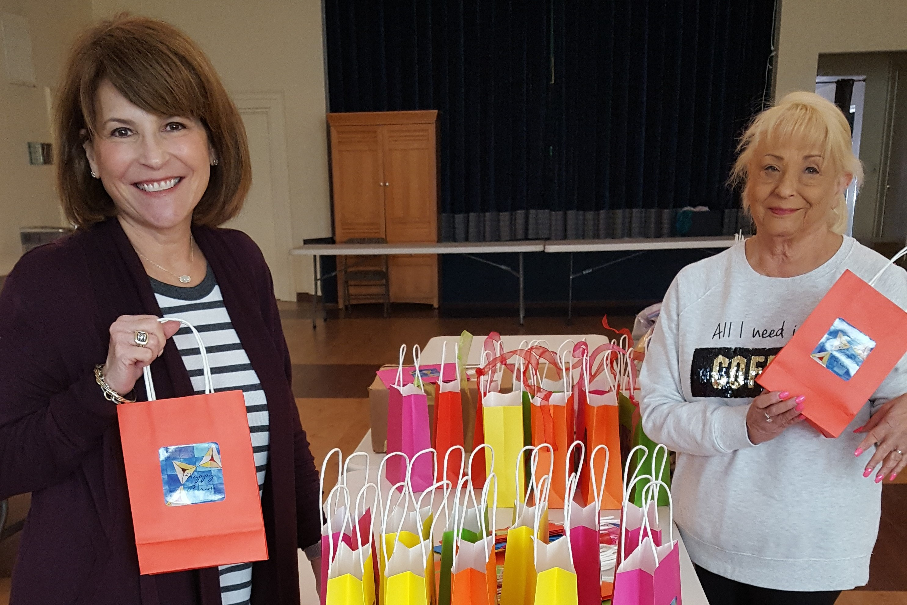 """<span class=""""slider_title"""">                                     Carolyn and Reba with Hamentaschen bags                                </span>"""