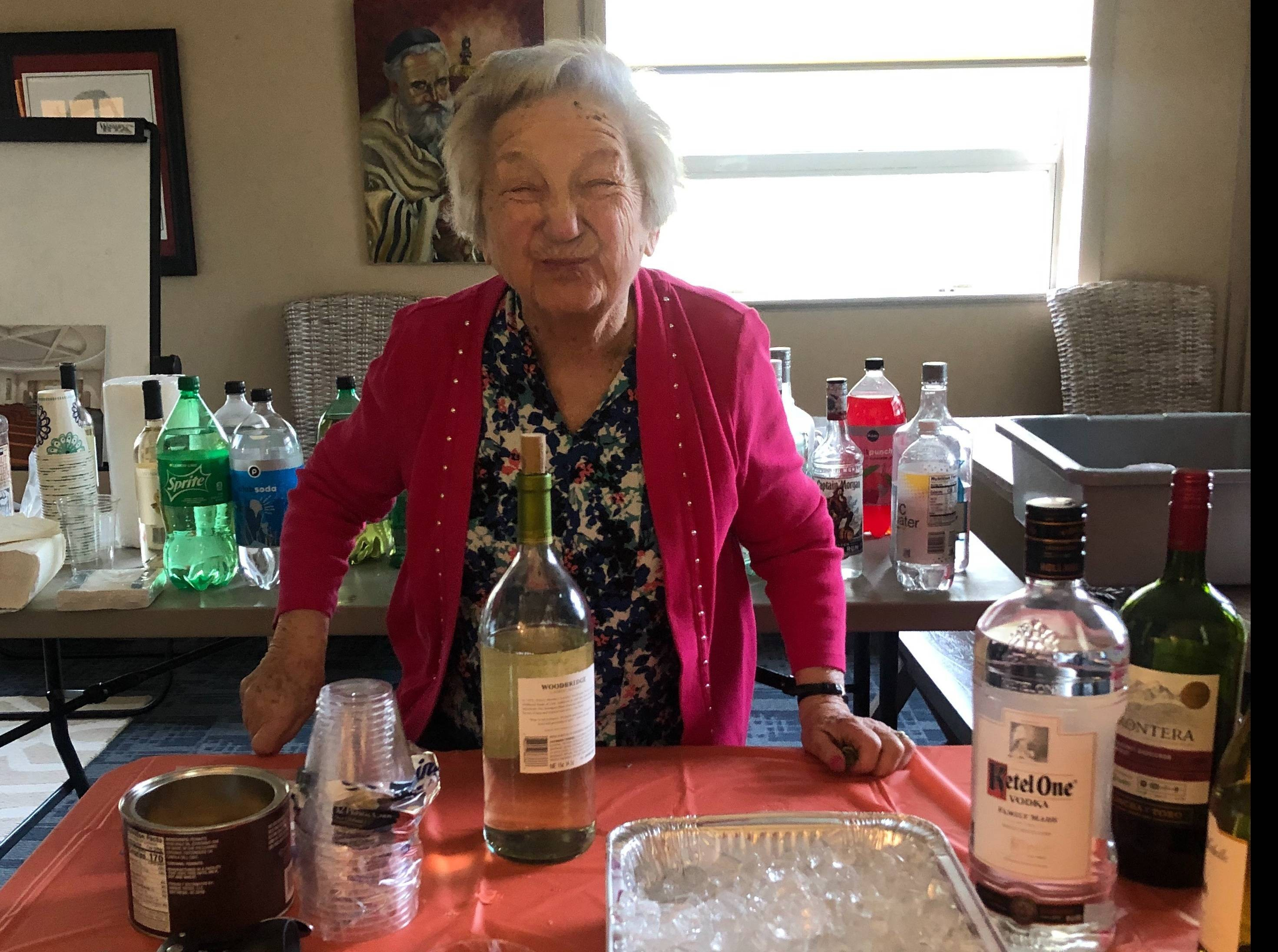 """<span class=""""slider_title"""">                                     Fran bartending at Purim Party                                </span>"""