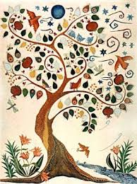 The Tree of Life mural is an artistic tree with spreading branches with multicolored leaves and birds.