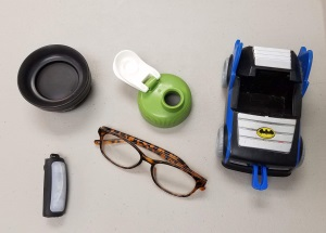 includes two travel mug lids and reading glasses