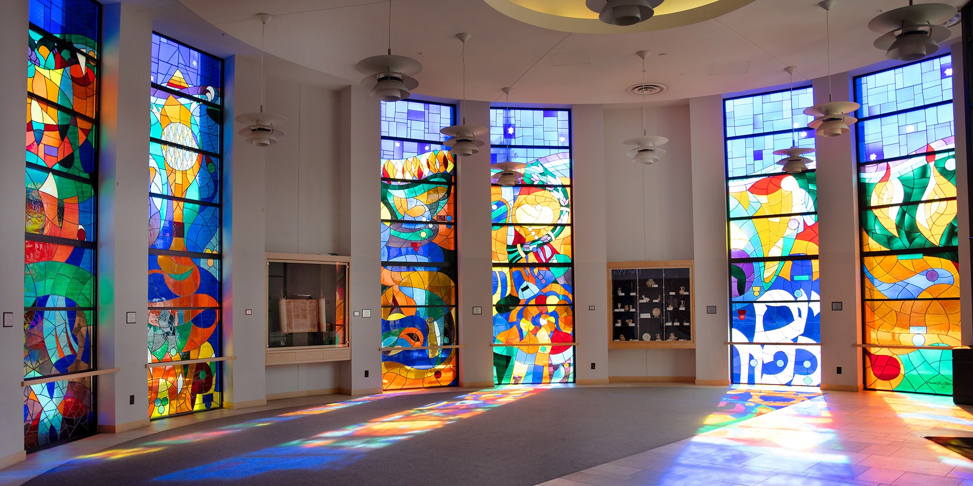 """<span class=""""slider_title"""">                                     Our Stained Glass Windows Tell Stories                                </span>"""