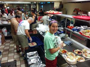 BI volunteers serving dinner at a food service