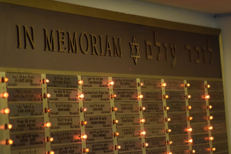 In Memoriam board with lights next to name plates of the departed