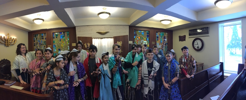 Group of religious school children, all wearing talit and tefillin