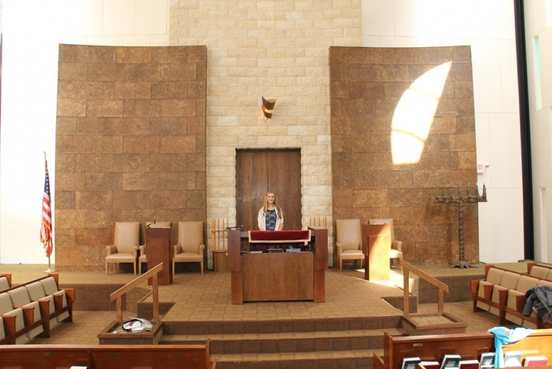 the new bimah is more inviting and accessible. Here, a congregant practices for her bat mitzvah.