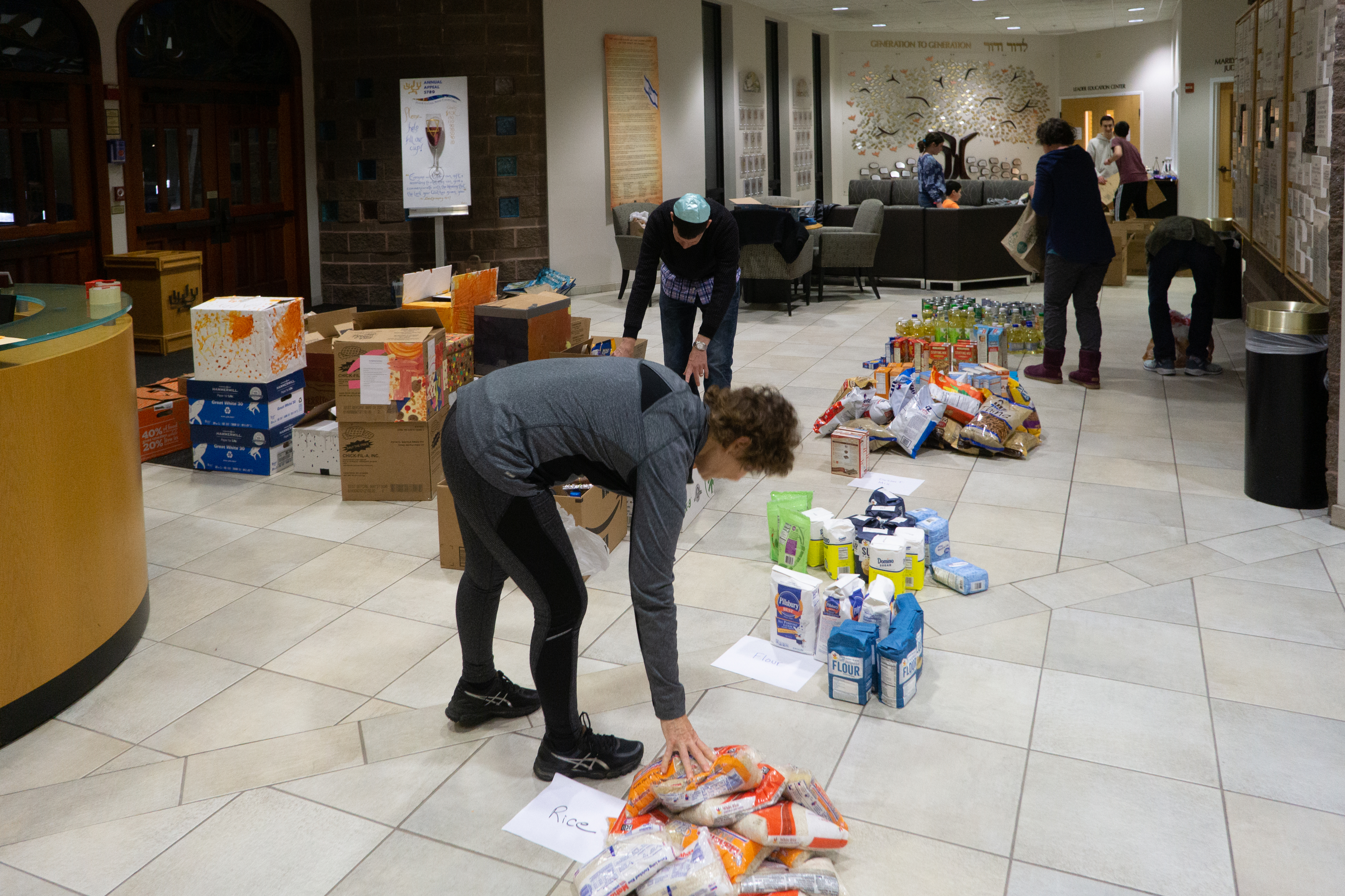 Thanksgiving food drive photo 2-sorting the separate items