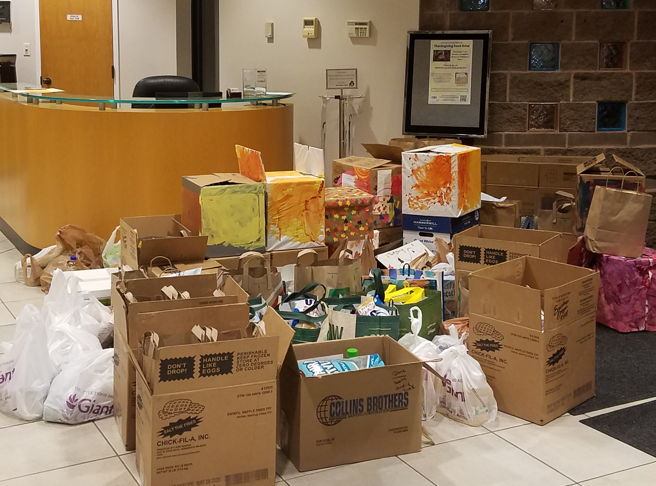 Thanksgiving Food Drive photo 1-piles in the lobby