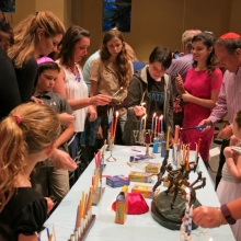 Families Lighting Chanukah Menorahs