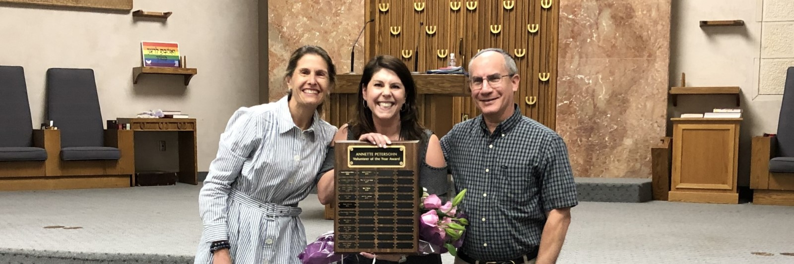 """<a href=""""/about-us""""                                     target="""""""">                                                                 <span class=""""slider_title"""">                                     Mazal Tov Jen Jacobs                                </span>                                                                 </a>                                                                                                                                                                                       <span class=""""slider_description"""">Volunteer of the Year</span>"""