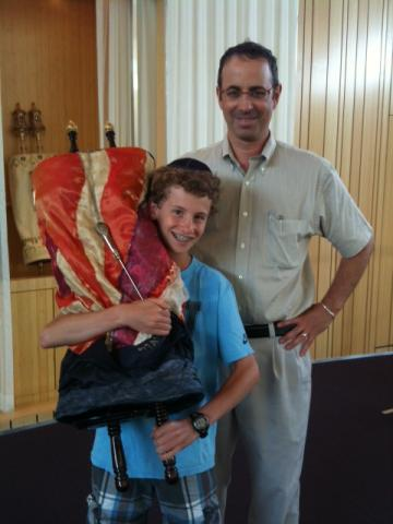Boy holding Torah
