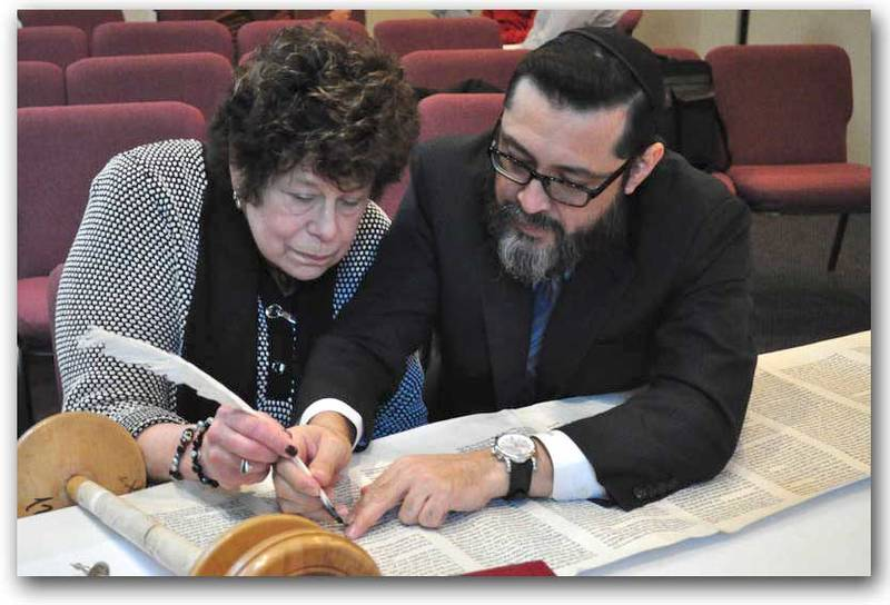 The year 5778 has been CBOI's Year of Torah. Rabbi Salazar and Sofer on Site has been working on restoring our Torahs to kosher condition, by sewing together the sheets of parchment and reinking letters that may have faded.  It has been our greatest joy to assist Rabbi Salazar in a once in a lifetime chance to 'help' him in scribing.