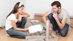 Man and woman building diy furniture