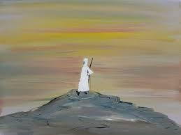 Avraham in white on a hill at sunset/sunrise