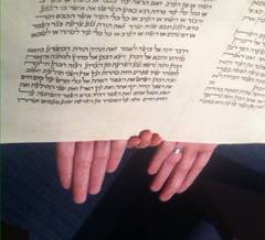 Hands holding Torah at Simchat Torah