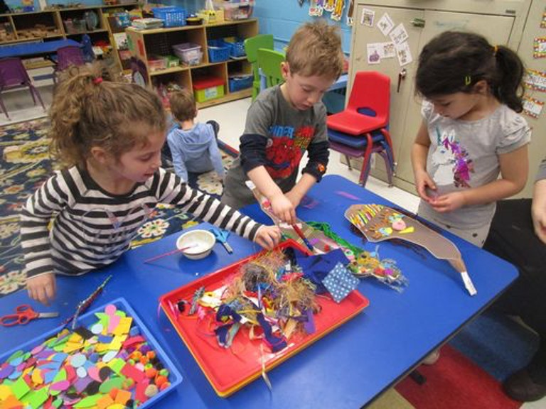 Children painting and working with crafts