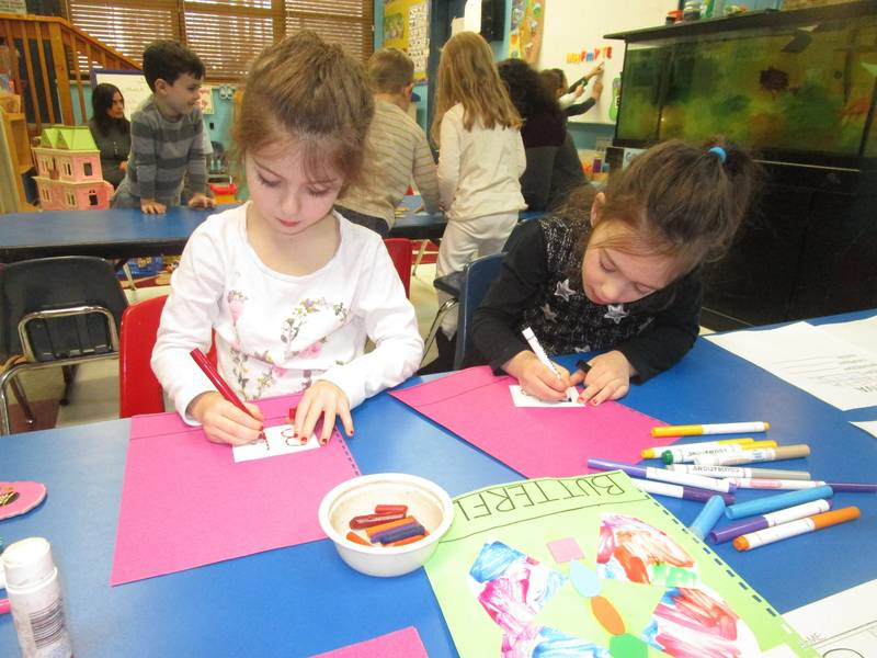Children coloring with markers