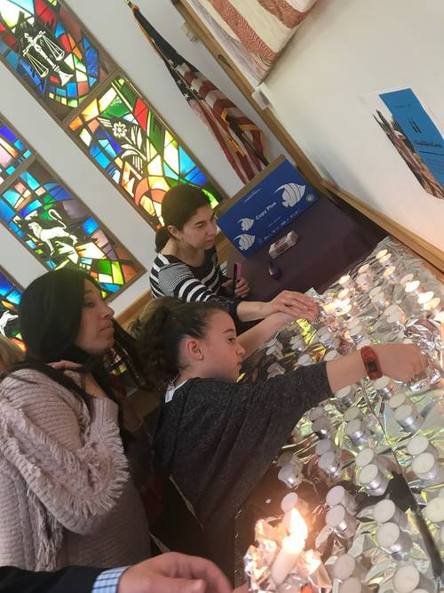 Young families and children at a Shabbat service