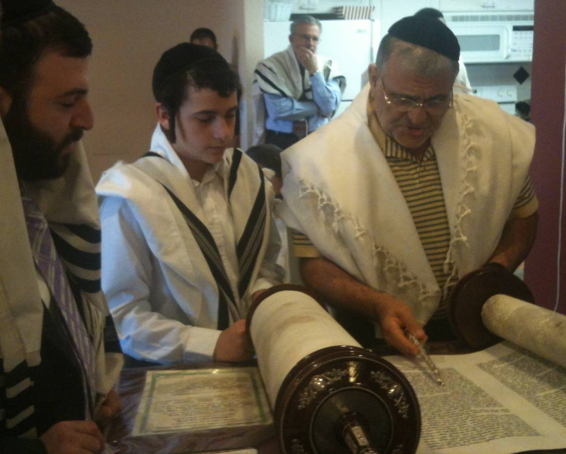 Photo of Men and Boy Reading from Torah
