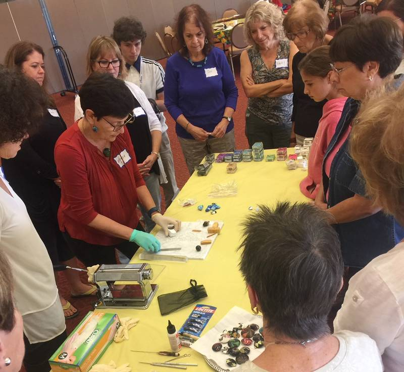"<span class=""slider_description"">Artist Varda Levram-Ellisman demonstrates techniques for making polymer clay beads at Festival Arts Series.</span>"