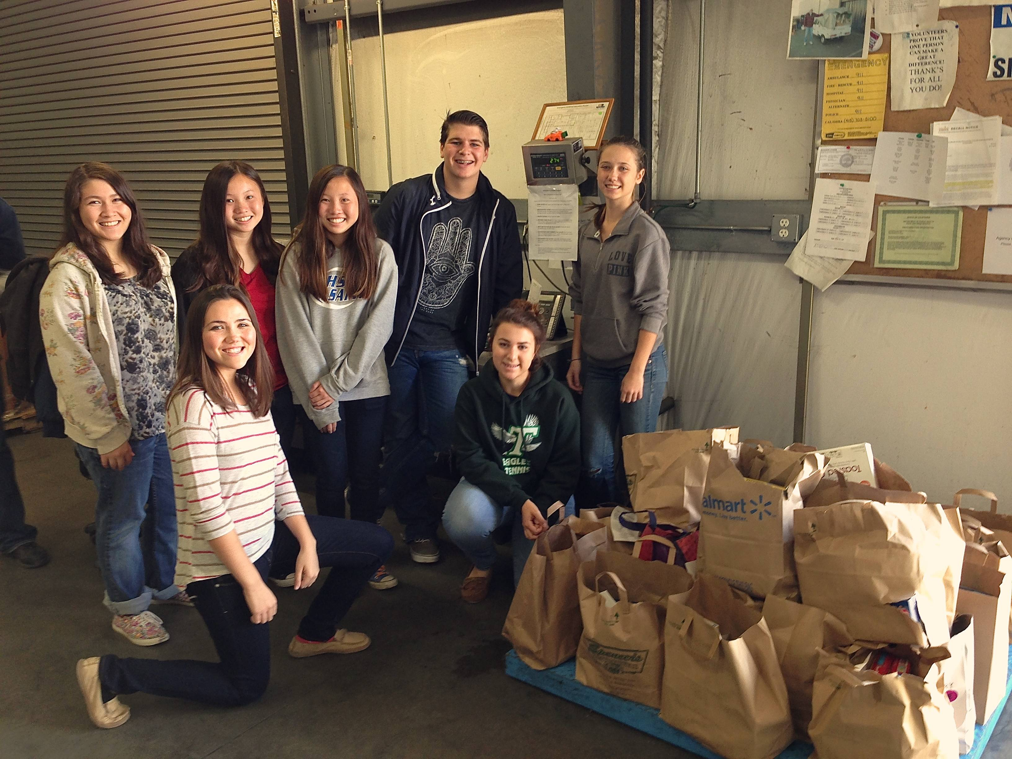 "<span class=""slider_description"">Youth group volunteering at Food Bank warehouse</span>"