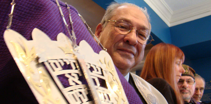 Older gentleman holding the Torah from Beth Israel (Stratford, Ontario)