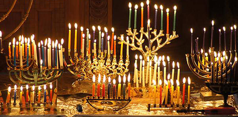 A large group of Menorah with all candles lite