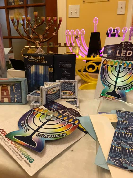 Various items from the Temple Israel Gift Shop including Chanukiah and Shabbat candlesticks.