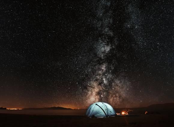 A tent under a starry sky.